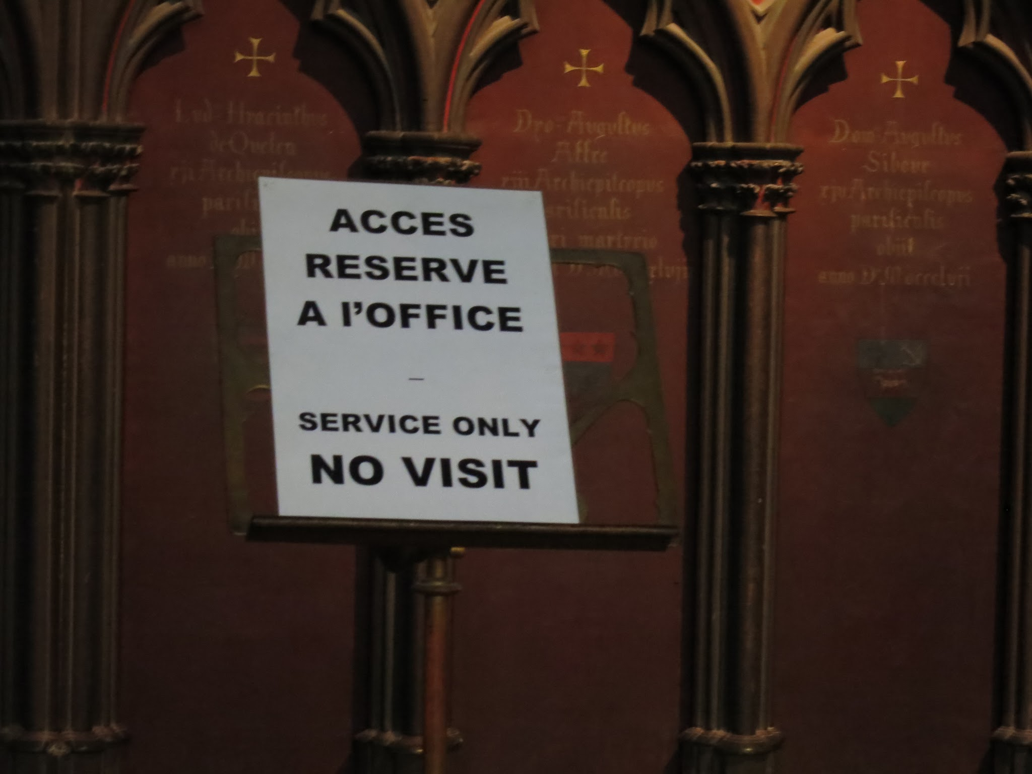 A sign found at Notre Dame in Paris. I guess they don't want visitors?